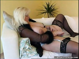 Beamy housewife with reference to stockings plays with new sex toy