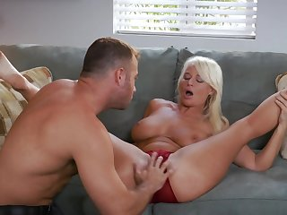 Handsome guy satisfies blonde boss London River on couch
