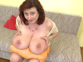 Jana P. licks her huge breasts and plays with her pussy