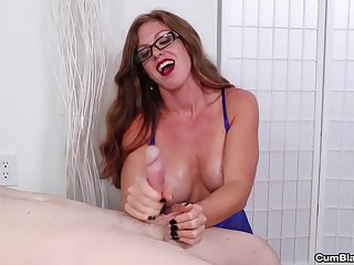 Mature with glasses whips the brush tits at large while stroking a dick
