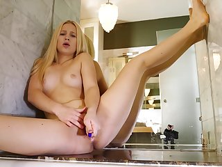 Teenie works her pussy like a real pro