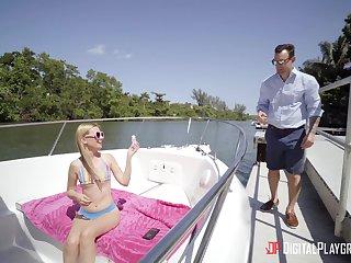 Skinny tow-haired pornstar Kennedy Kressler spreads her legs on a boat