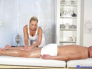 Sexy blonde model gives a careful massage and rides his large dig up